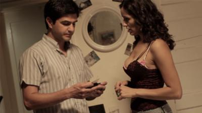 Miguel (Dan Lopecci) and Star (Romina Peniche) at her place.